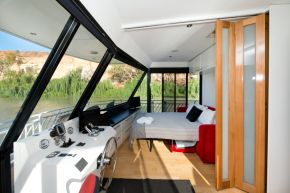 Second lounge and sofa bed area on Loud Whisper Houseboat moored at Customs House Houseboat Marina
